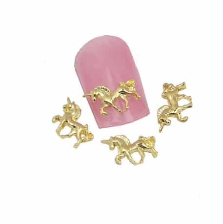 Unicorn nagel studs in goudkleur
